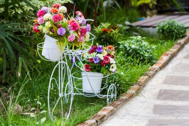 Vintage style bicycle with flowers.