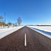 Classic winter scene of a highway in rural area