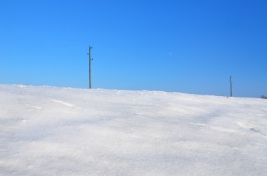 Electricity power lines in winter field
