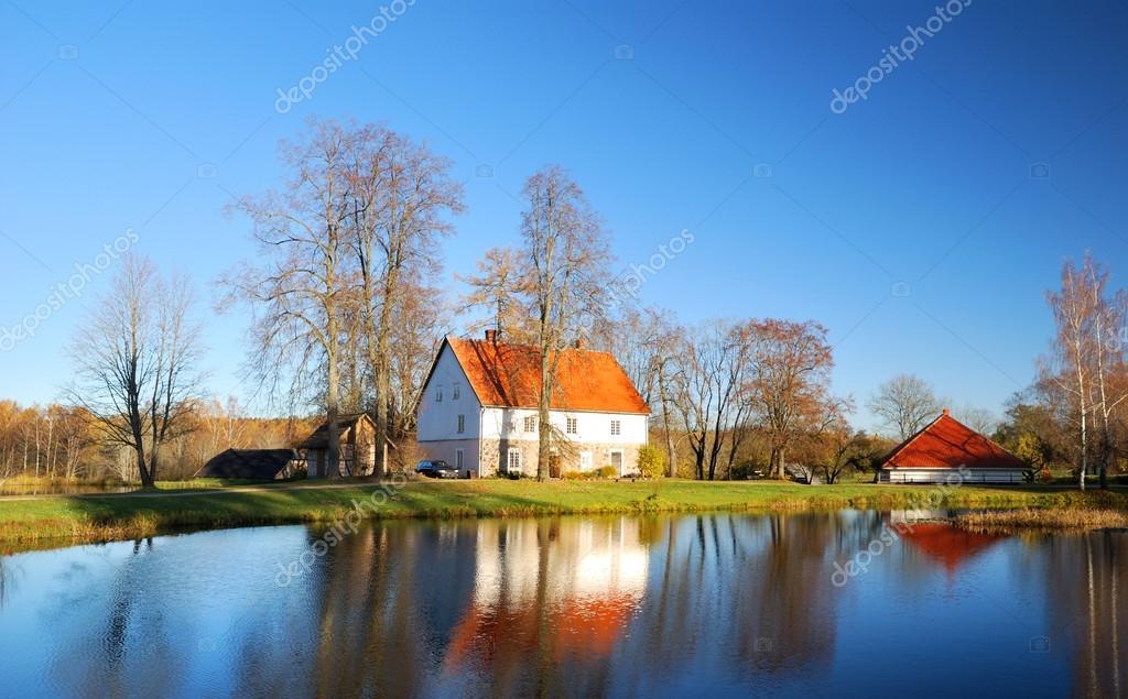 house at the lake bank in autumn. Sigulda, Latvia