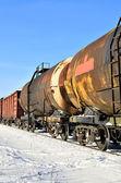 Fotografie Grunge-Fracht-Zug unterwegs im winter