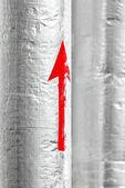 Fotografie červená šipka na vodní potrubí