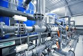 Fotografie New plastic pipes and colorful equipment in industrial boiler room