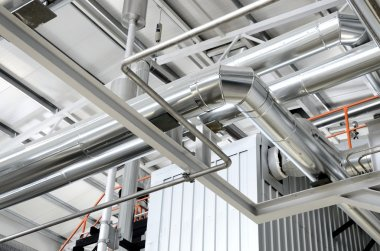 New shiny pipes in industrial boiler room