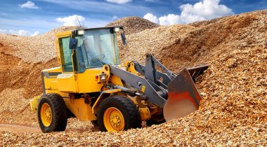 bulldozer working in sawdust
