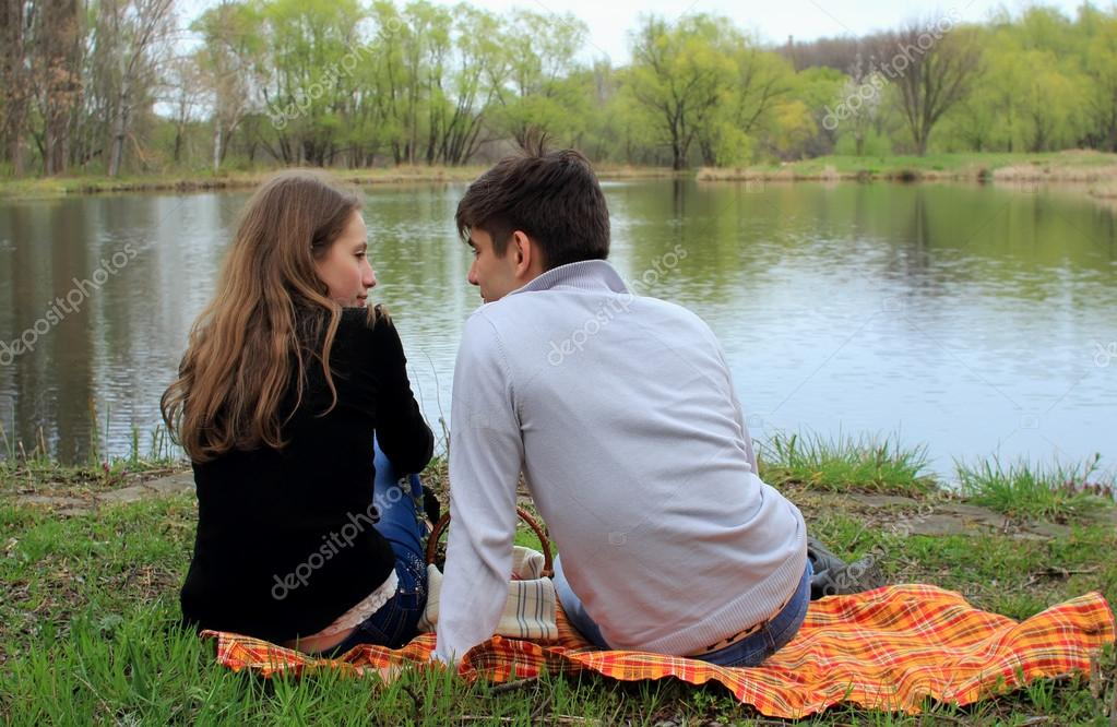 Two lovers sit by the lake in the park stock photo for 2 lovers pic
