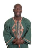 Fotografie African man with traditional clothes and crossed arms