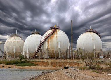 Big Industrial oil tanks in a refinery and Drainage system with