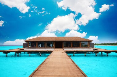 A beach house floating on the water