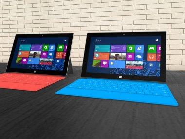 Microsoft Surface Pro tablets on a shelf.