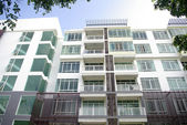 Photo Modern condominium, apartment with white and lot of glass