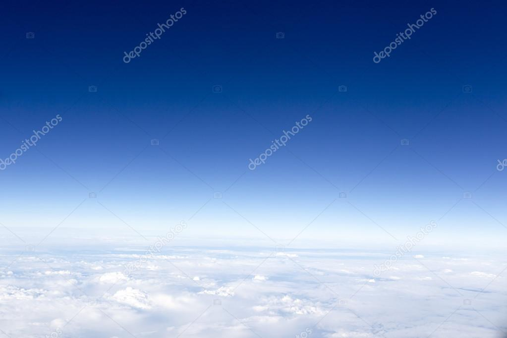 clouds. top view from the window of an airplane flying in the cl