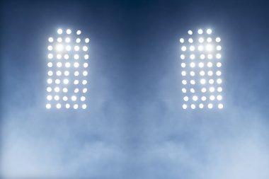 Stadium lights against dark night sky backgroundon