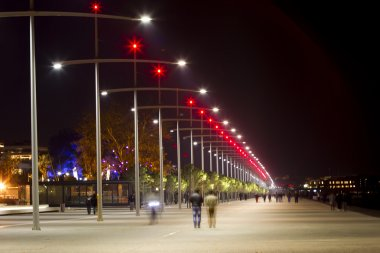 Lit street lights at night in Thessaloniki, Greece.