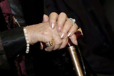 Elegant woman's hand on cane