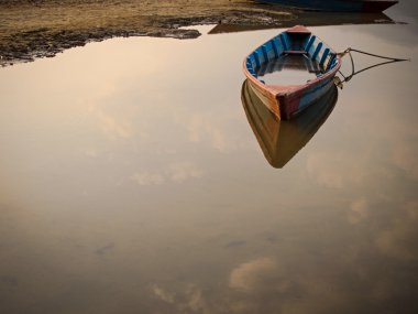 Rowing Boat Floating on the Still Waters of a Lake