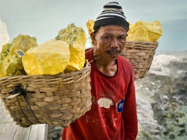 Sulfur Miner at Kawah Ijen Volcano in East Java, indonesia