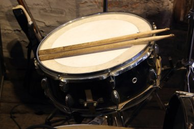 Drums conceptual image. Snare drum and stick
