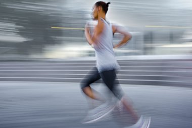 athlete running on the city street
