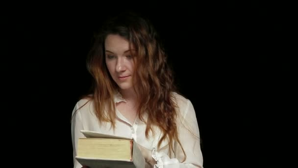 Woman Opening and Closing a Book With Inspiration
