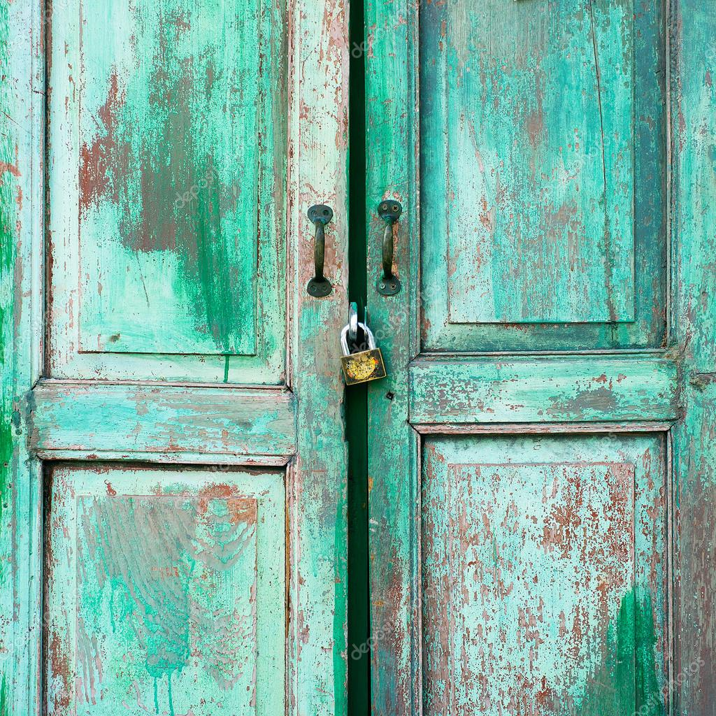 A Weathered Green Door And Old Key Vintage Stock Photo