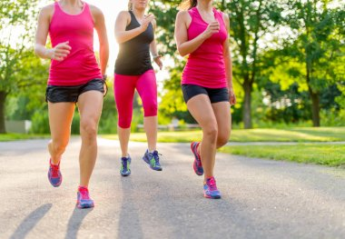 group of women jogging in nature