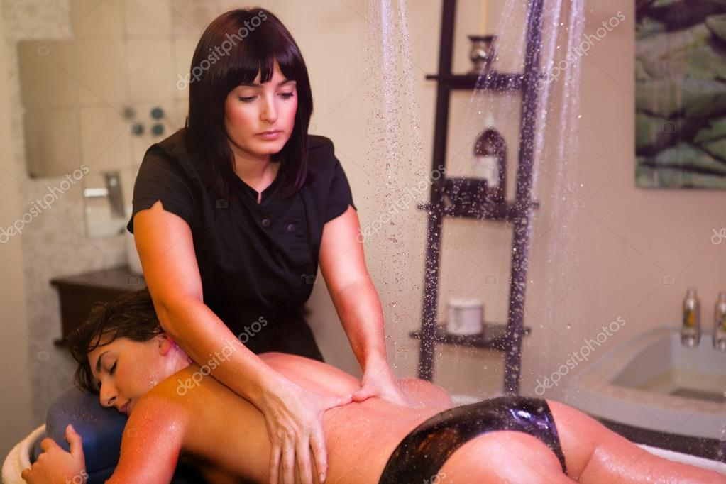 Black women giving massages