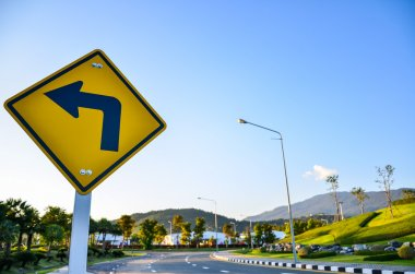 Turn left traffic sign on road