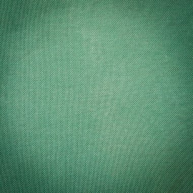 green fabric texture and background close up