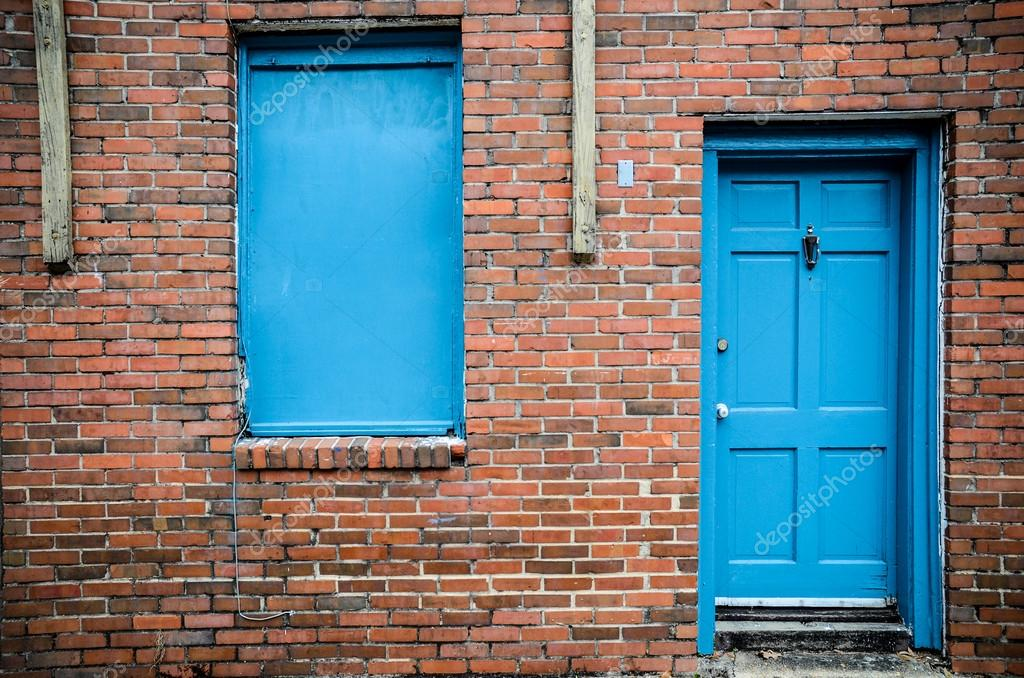 windows new orleans blue door and windows brick building treme new orleans stock photo