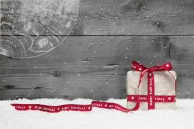 Christmas present with ribbon, snow
