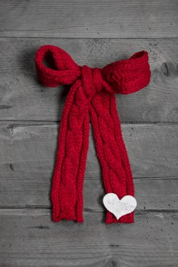 Red knitted bow with white heart