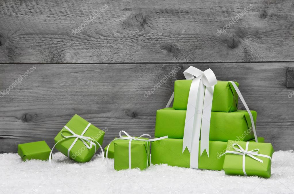 Green Christmas presents with snow