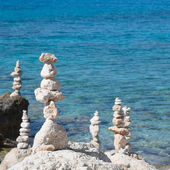 Pebbles and stones stacked on seashore