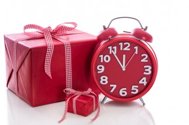 Big gift box with red alarm clock