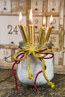 Four golden christmas candles
