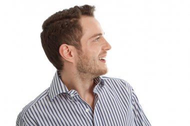 Hearing - Young man in blue shirt looking sideways isolated on w
