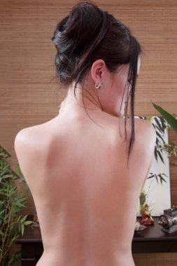 Bare back of Asian woman - thai massage