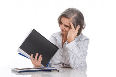 Overworked woman stressed at work
