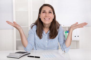 Young woman is happy at work in their office