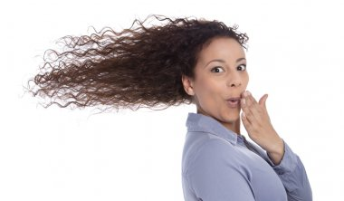 Windy : surprised woman with blowing hair in wind isolated on white