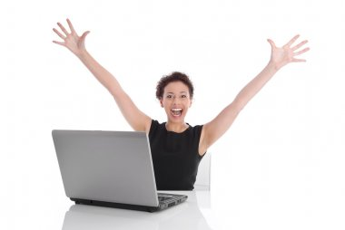 Successful young business woman at desk with computer