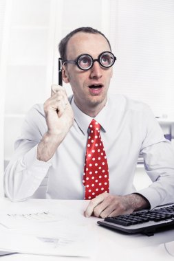 Clever young businessman with bald have a solution working as scientist