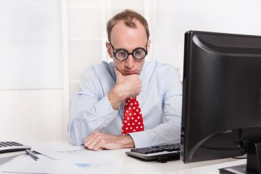 Frustrated man with burn-out syndrome - sad sitting at his table