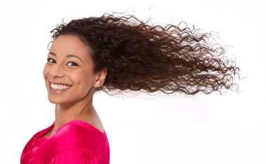 Windy: laughing woman with blowing hair in wind isolated on whit