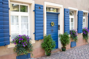 Flowers and plants decorating house exterior