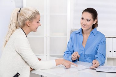 Two business woman at desk - application or interview - talking
