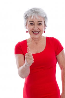 Powerful and successful older woman - thumbs up isolated on whit