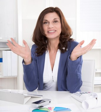 Attractive senior managing director gesturing with hands.