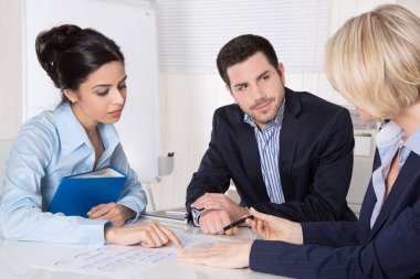 Successful business team in a meeting sitting at desk